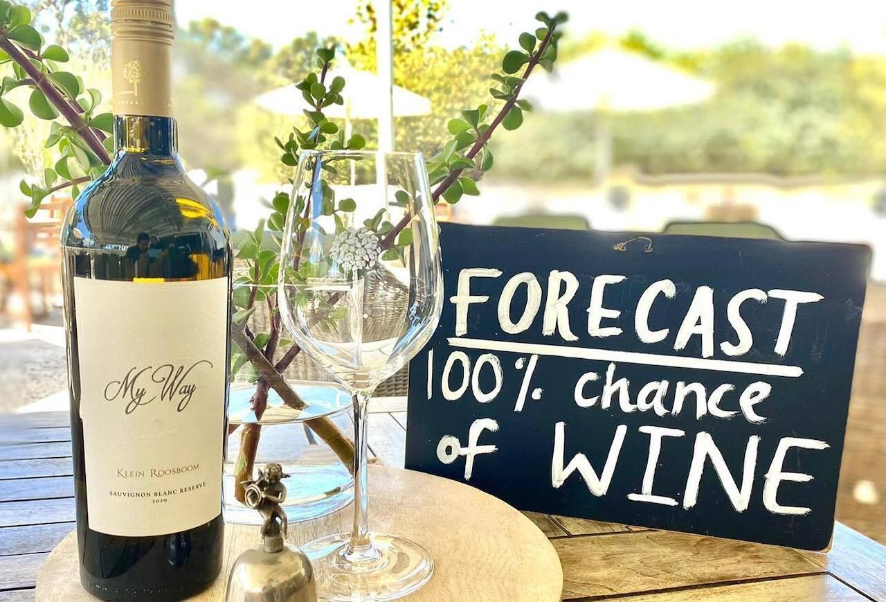Klein Roosboom Boutique Winery wine glass and bottle, scenic views in Capetown