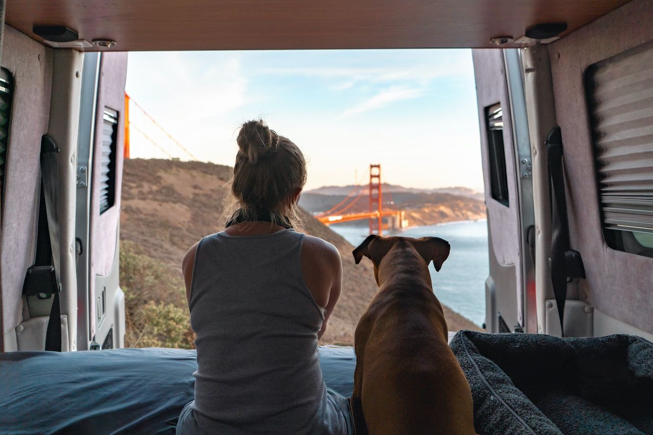 Woman and dog in a van, best states for vanlife