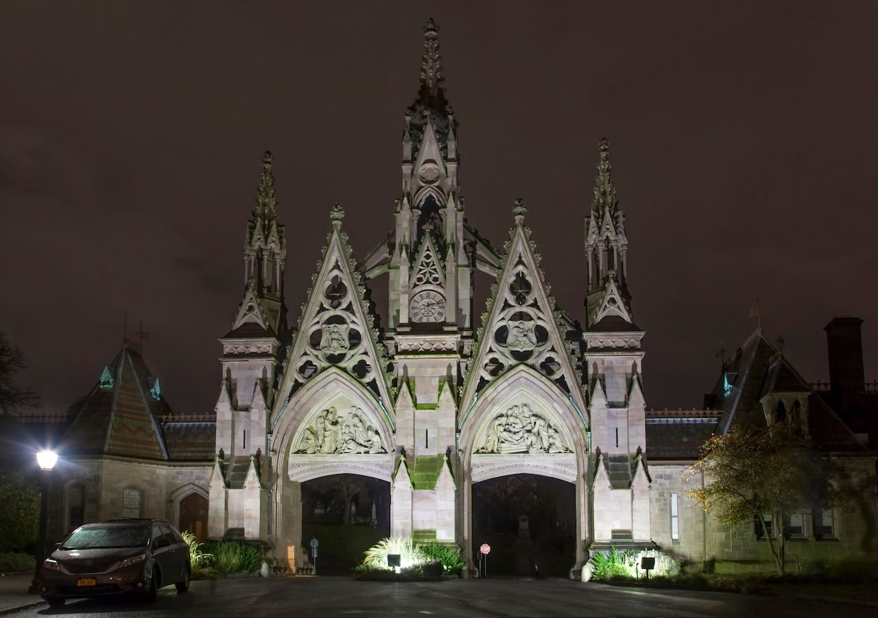 Green-Wood cemetery Gate entrance at night., best outdoor events in new york city 2021
