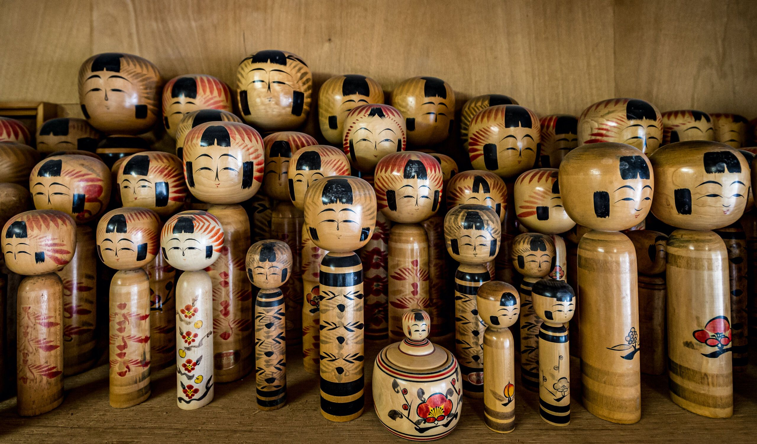 Japanese traditional folk art kokeshi dolls with various expressions, museums in japan