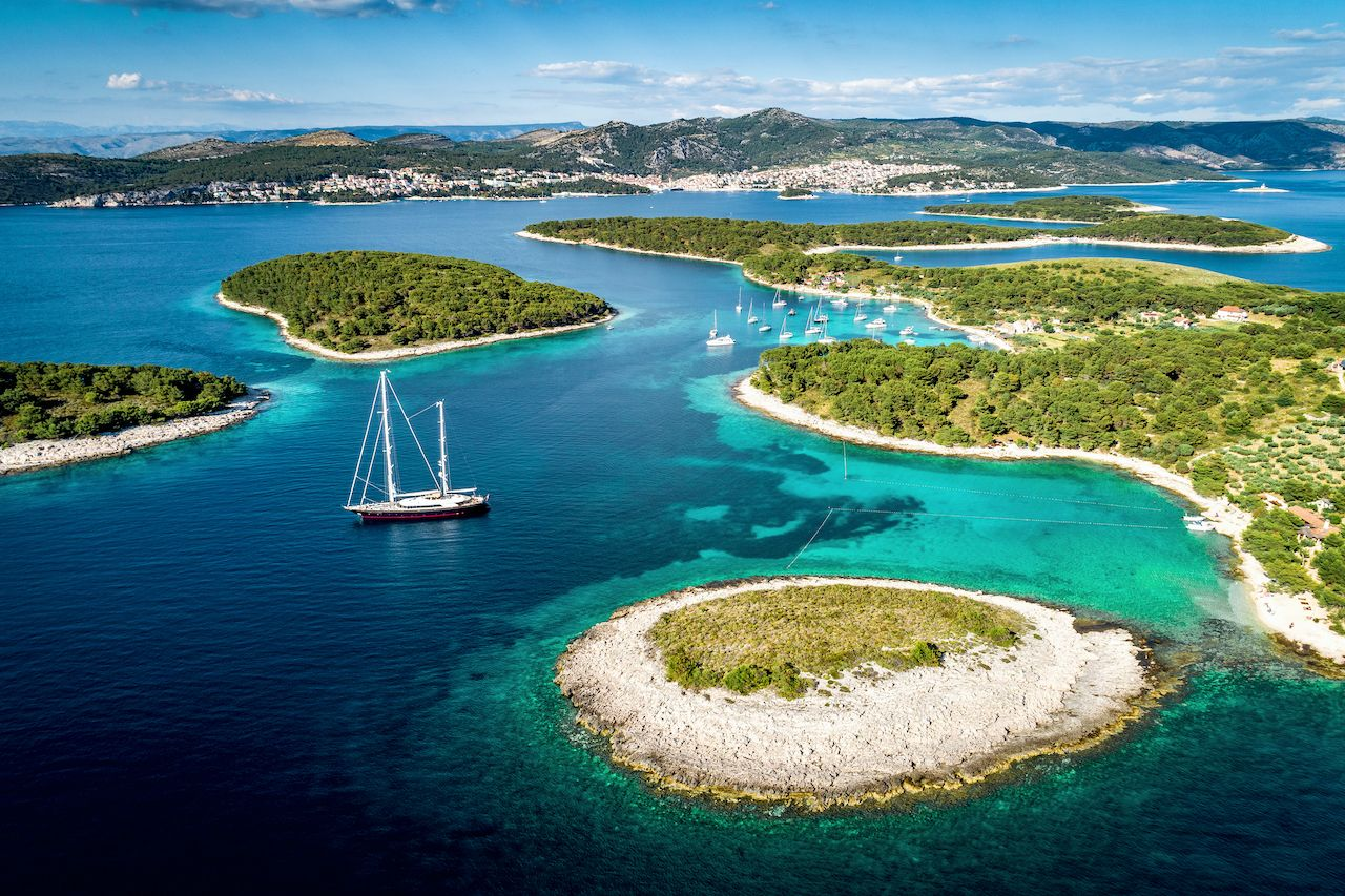 Aerial view of Paklinski Islands in Hvar, Croatia. Turquise water bays with luxury yachts and sailing boats. Toned image., travelzoo deal