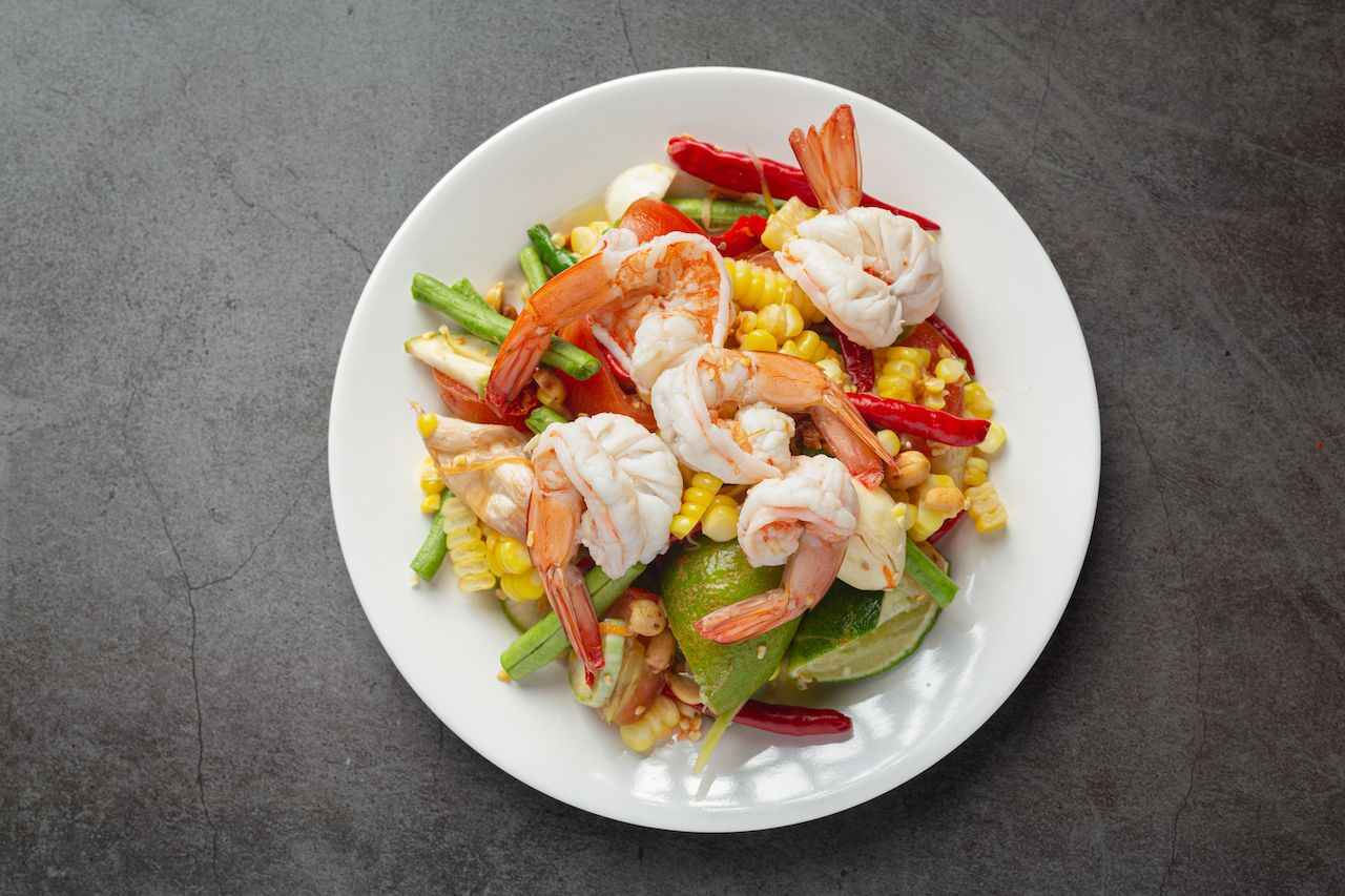 Som Tum with Corn and Shrimp, served with rice noodles and green salad Decorated with Thai food ingredients., australian cuisine
