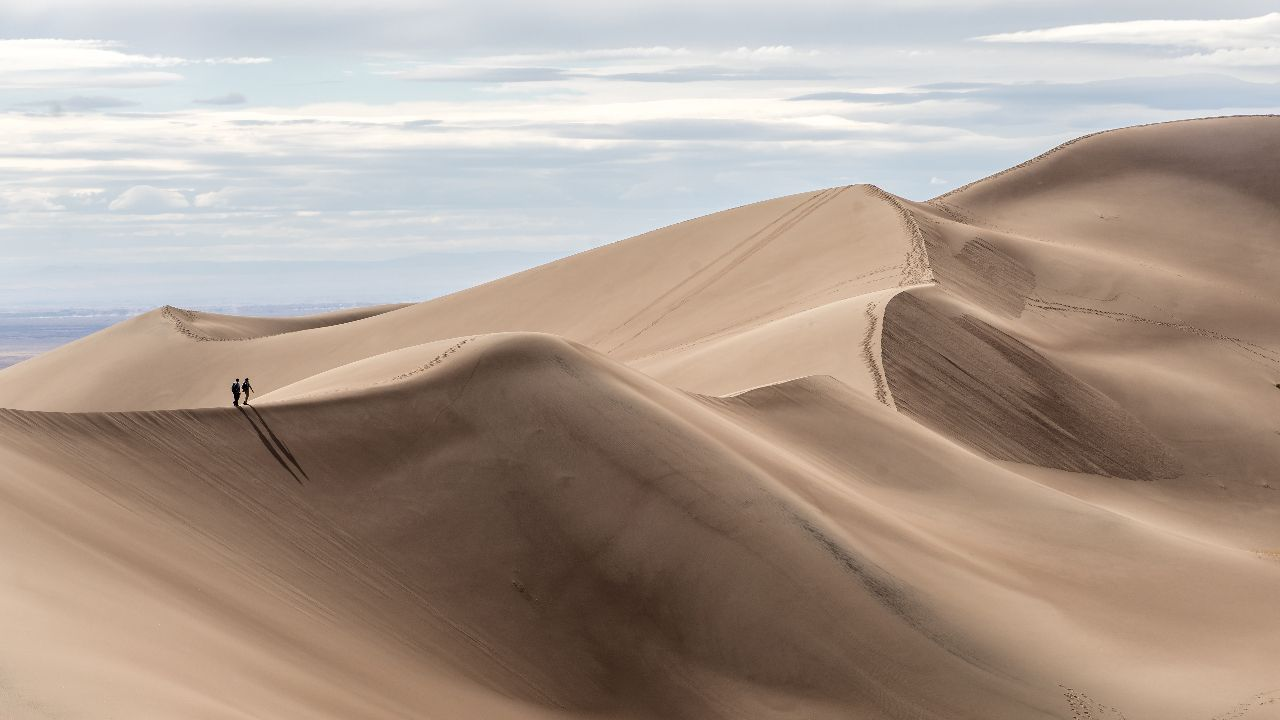 Couples hike in Great Sand Dunes National Park, Colorado, national park reservations