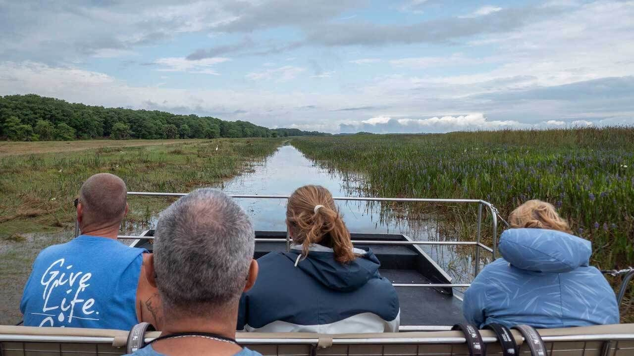 Zoom on an airboat across Cypress Lake, outdoors in central florida