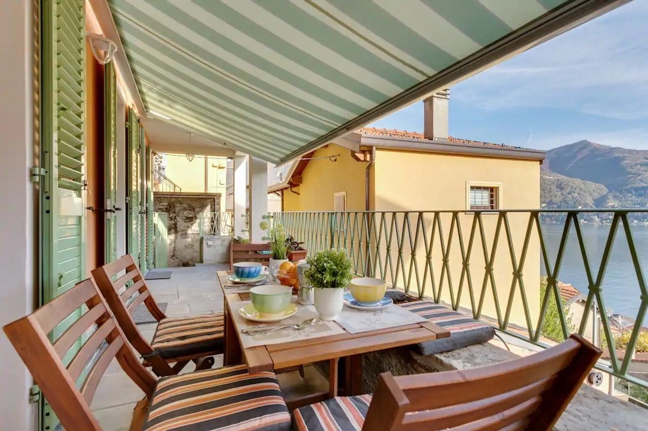Apartment overlooking Lake Como Airbnb outside deck dining table, Lake Como airbnbs
