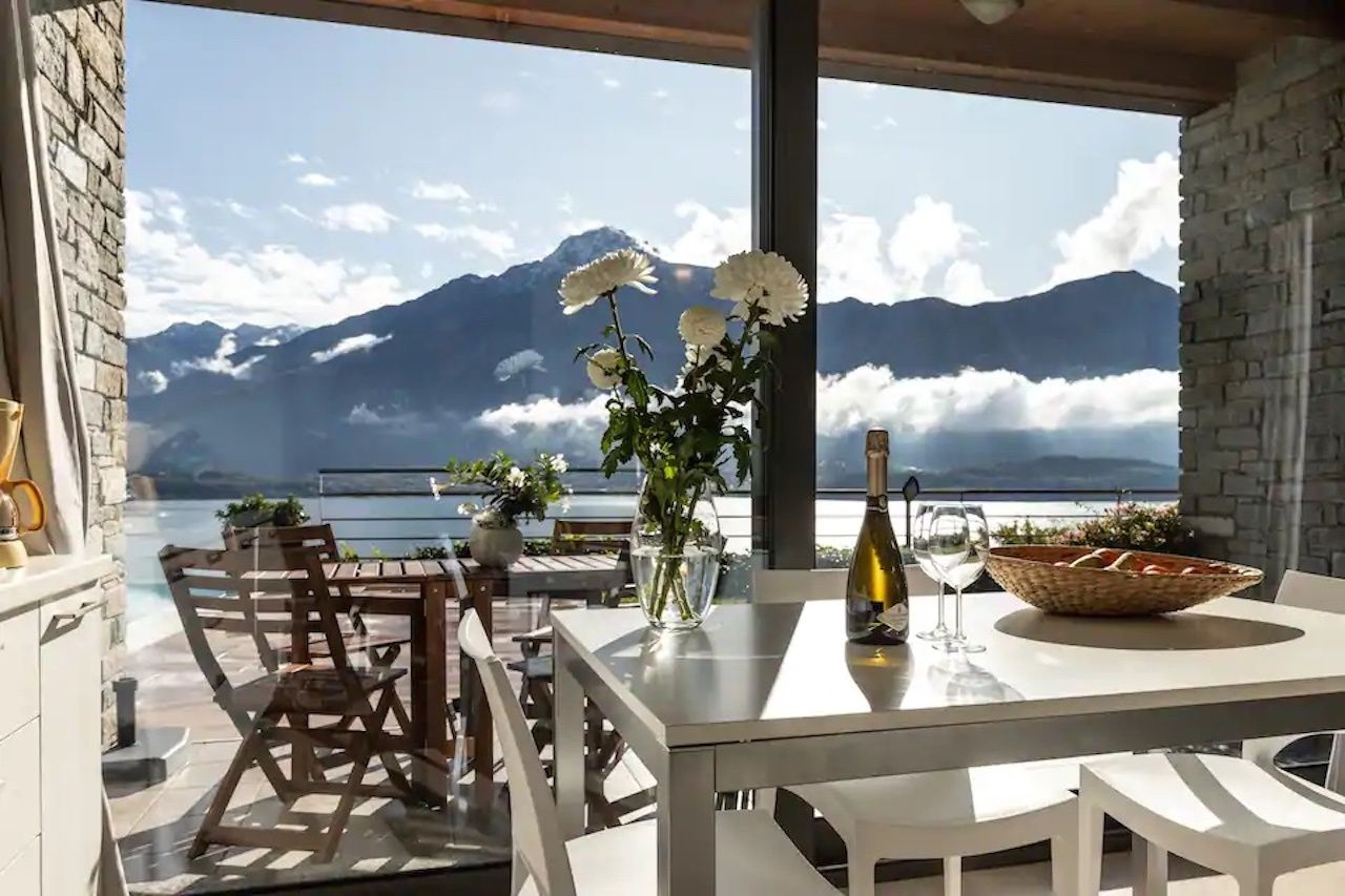 Beautiful one-bedroom apartment in Vercana Aribnb dining room with mountain view, Lake Como Airbnbs