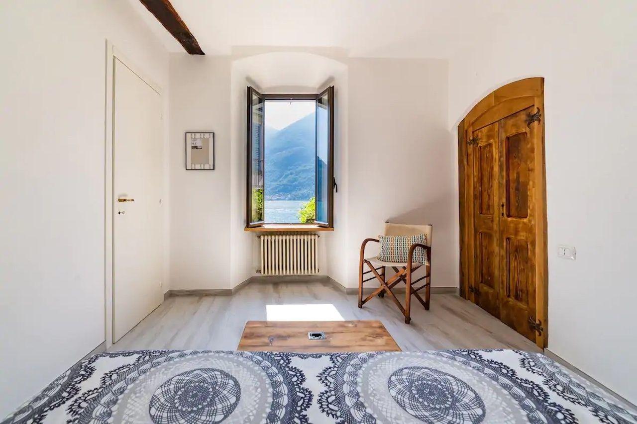 Ca del Bif Airbnb entrance with open window, Airbnbs in Lake Como