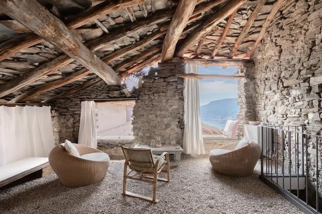 Casa Berta in Palanzo Airbnb living room with white furniture, Lake Como airbnbs