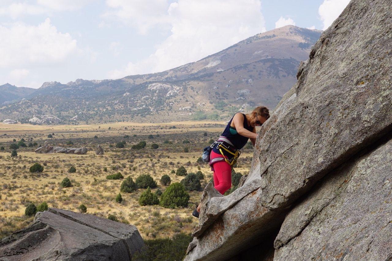 City of Rocks, climber in red leggings