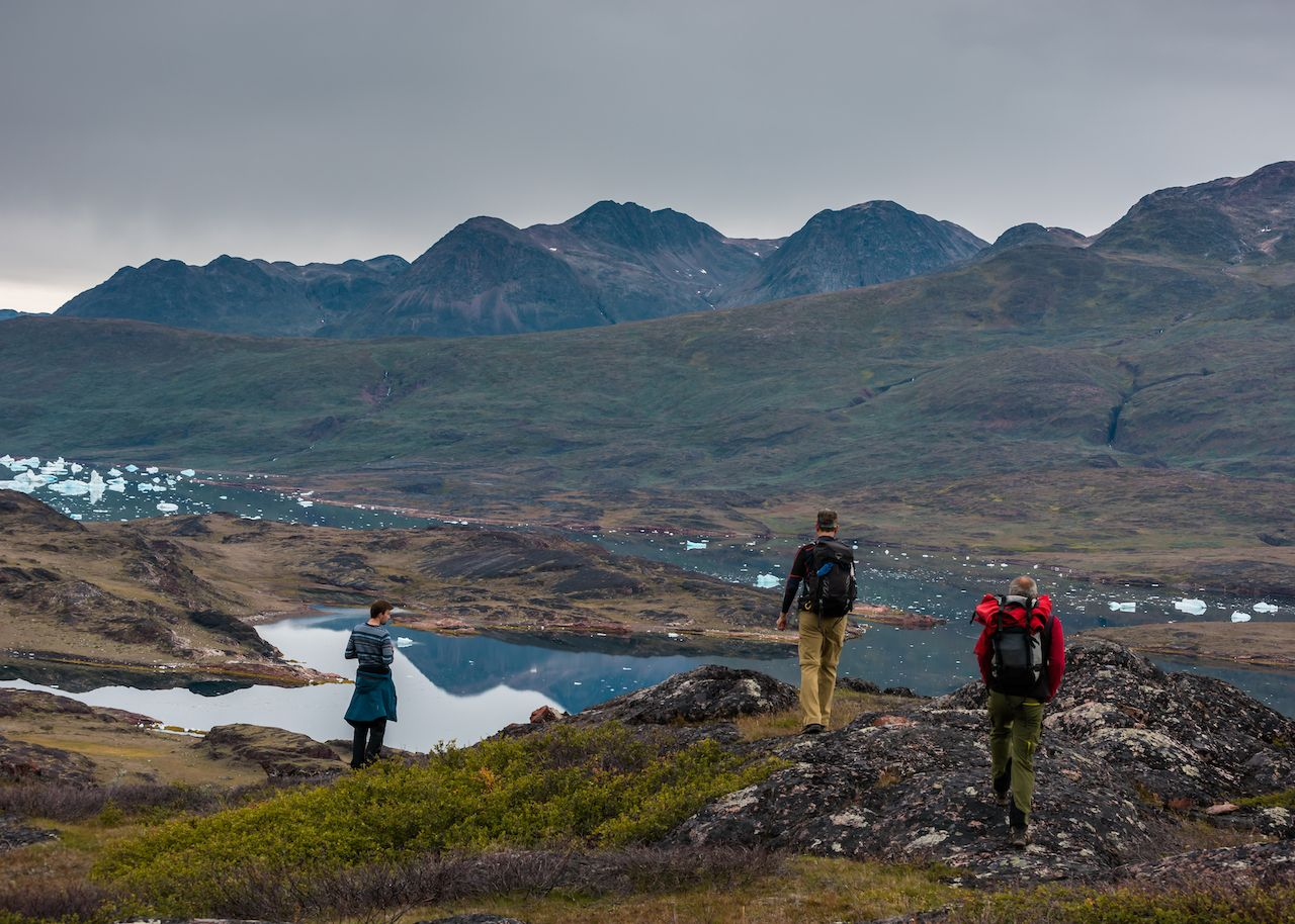 Greenland hiking mountains and ice-filled lake