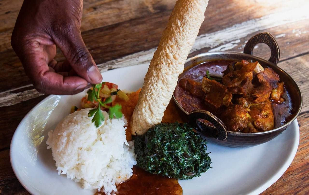 local favorite dish pata pata served with rice, Maboneng district Johannesburg