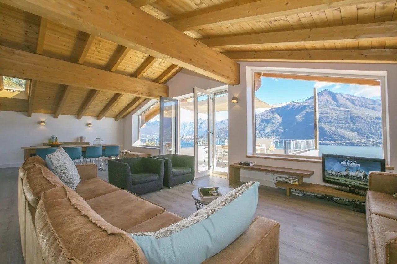 Penthouse di Cremia Airbnb living room with couch and chairs, Lake Como airbnbs