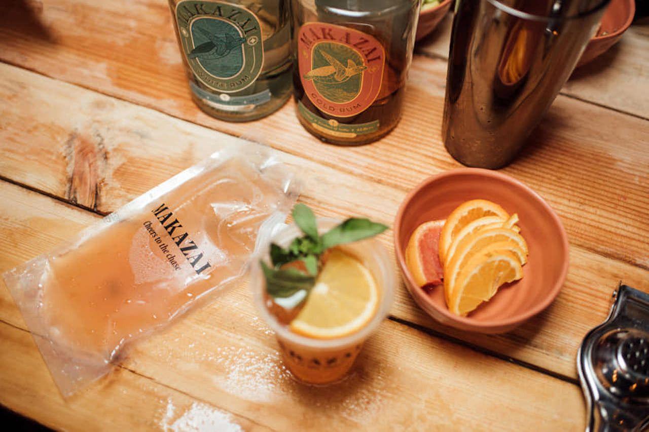 Maka Zai Rum liquors with shakers and orange slices, Indian craft spirits