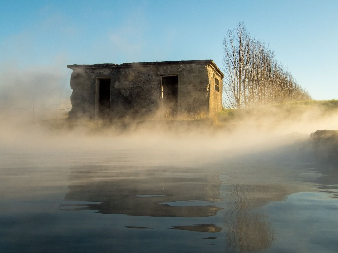 photo of the oldest pool in Iceland, Gamla Laugin, villages in Iceland