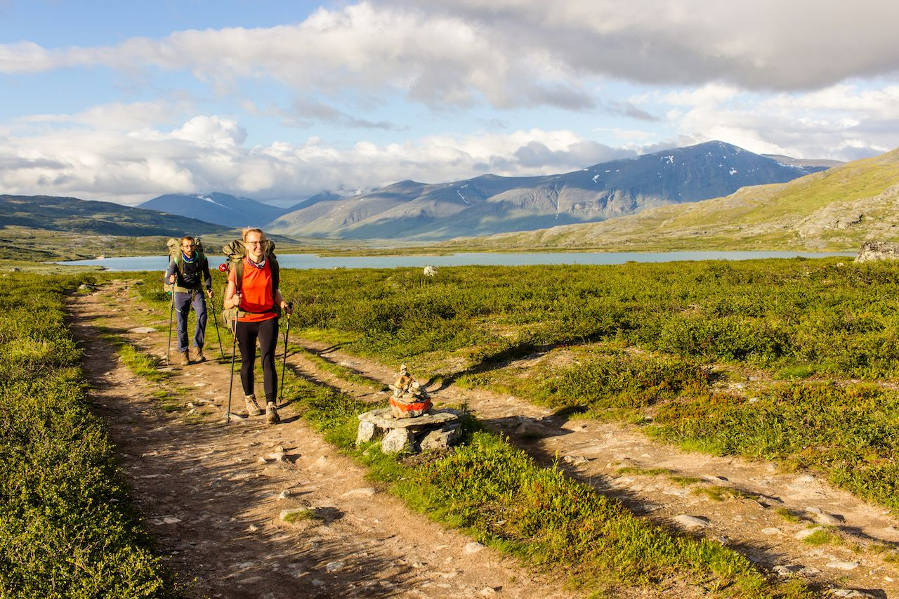 Couple,Hiking,In,Swedish,North,Going,For,The,Hut.,Side