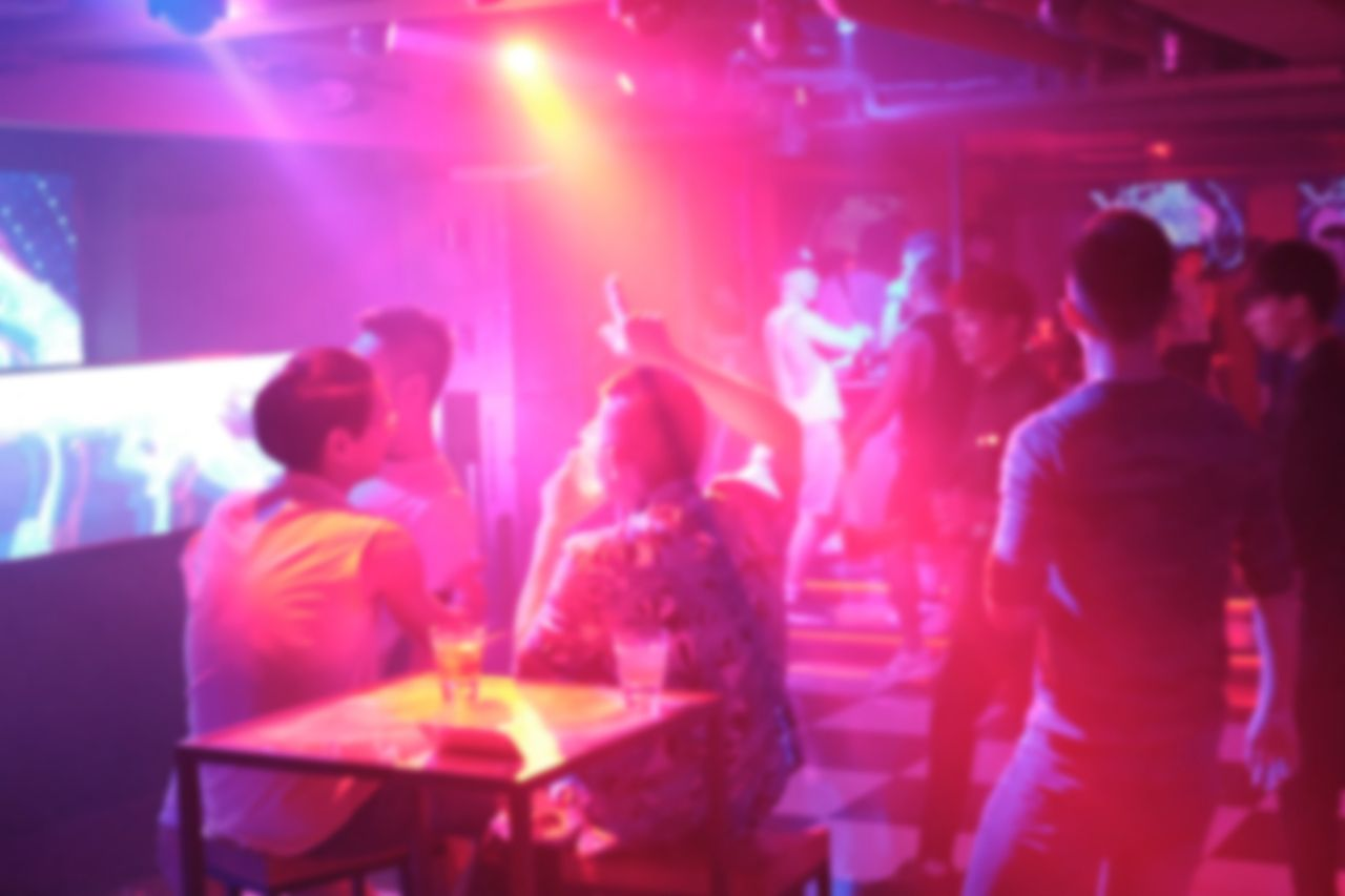 LGBTQ safe spaces US, Abstract and blurred image of people drinking and dancing in the night club, photoed in Taipei