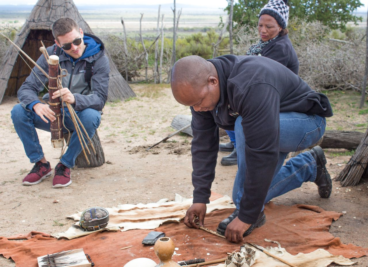 !Khwa ttu San Culture and Education Centre, Yzerfontein, West Coast, South Africa - August 28th, 2018. A tour guide is demonstrating fire making as done in the San Bushmen culture.