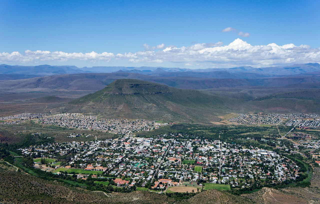 View of the town of Graaff-Reinet in the Karoo seen from above at the valley of desolation, small towns in South Africa