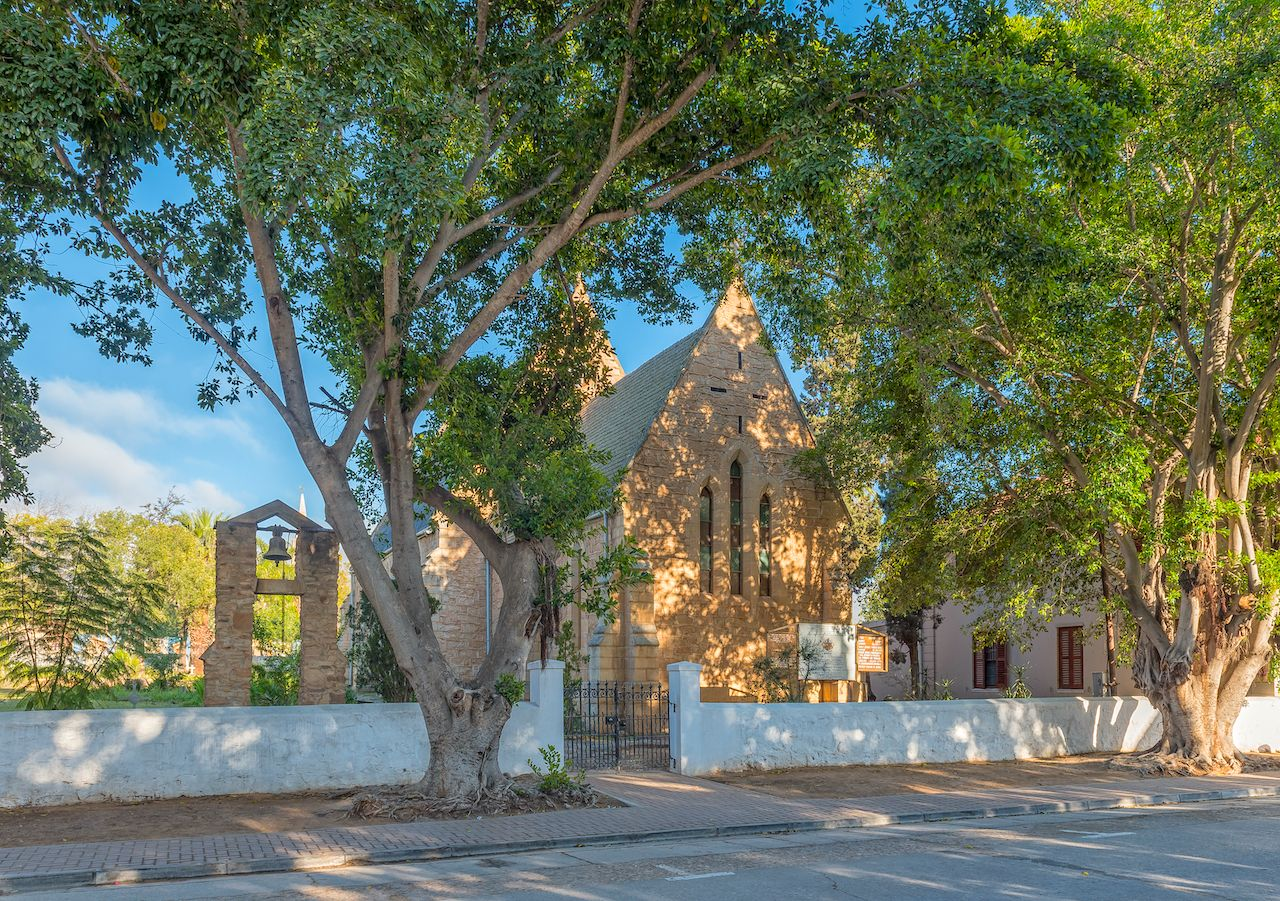 CLANWILLIAM, SOUTH AFRICA, AUGUST 28, 2018: The historic Anglican Church in Clanwilliam in the Western Cape Province. The belfry and bell are visible, small towns in South Africa