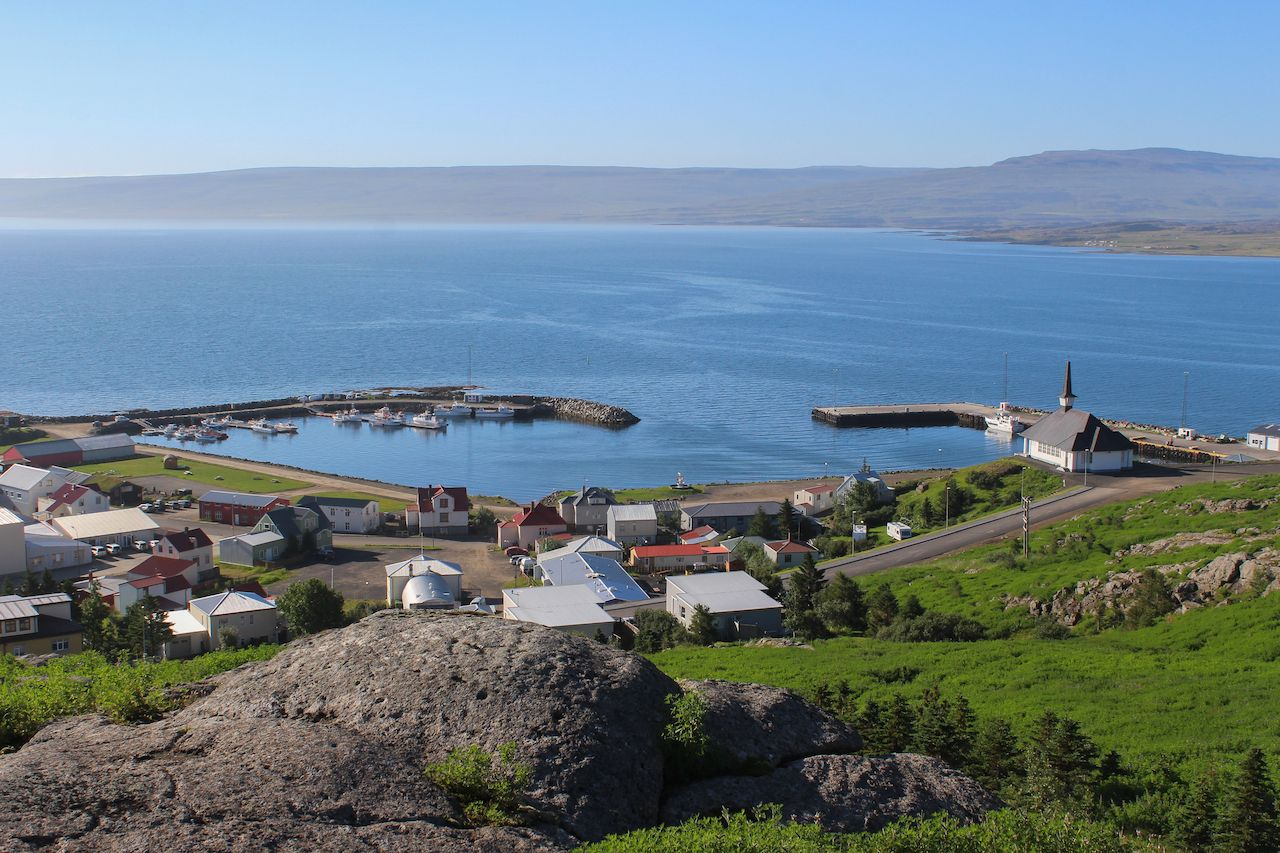 Holmavik Iceland westfjords while summer blue water with village green grass and stones, villages in Iceland