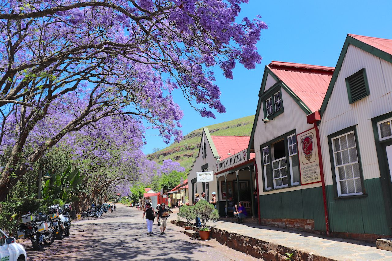 Tourists in street of historic gold mining town , small towns in South Africa