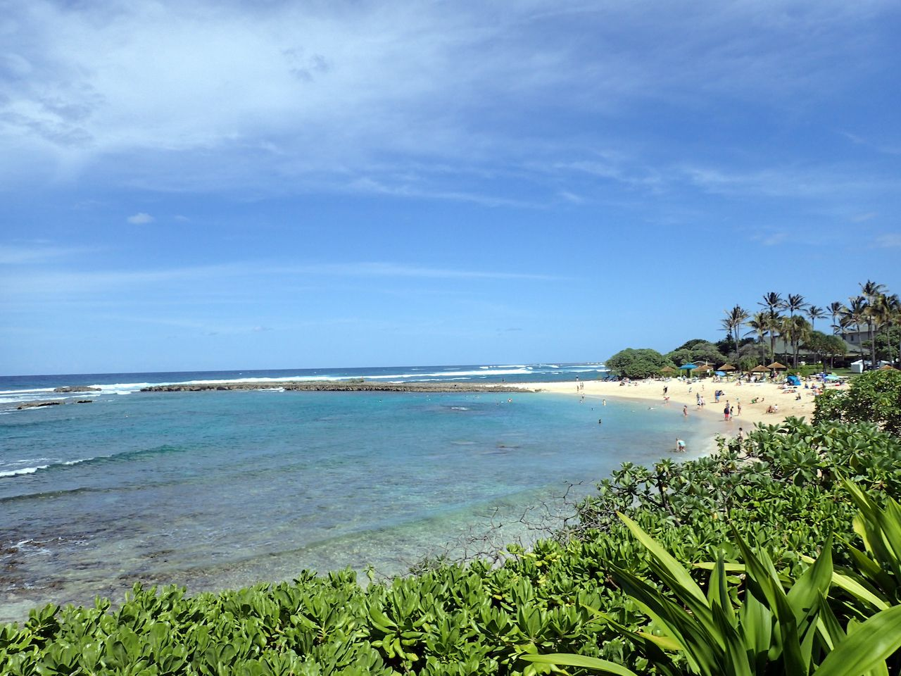 People play at Kuilima Cove Beach at Turtle Bay, Oahu Island North Shore, Hawaii, Oahu beaches for families