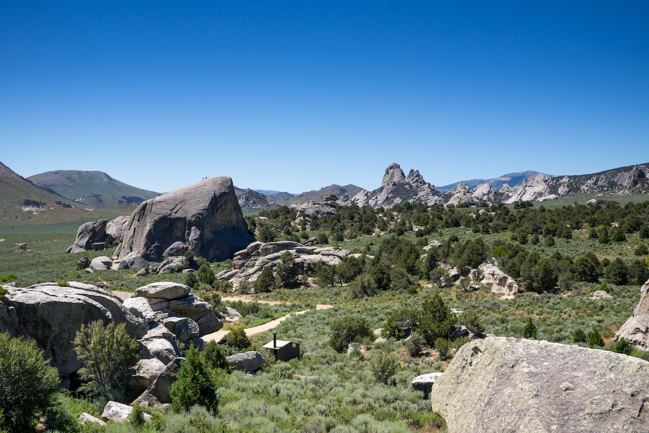 Rocky scene from City of Rocks, Idaho. View of granite rock formations protruding from ground where rock climbers would go., city of rocks