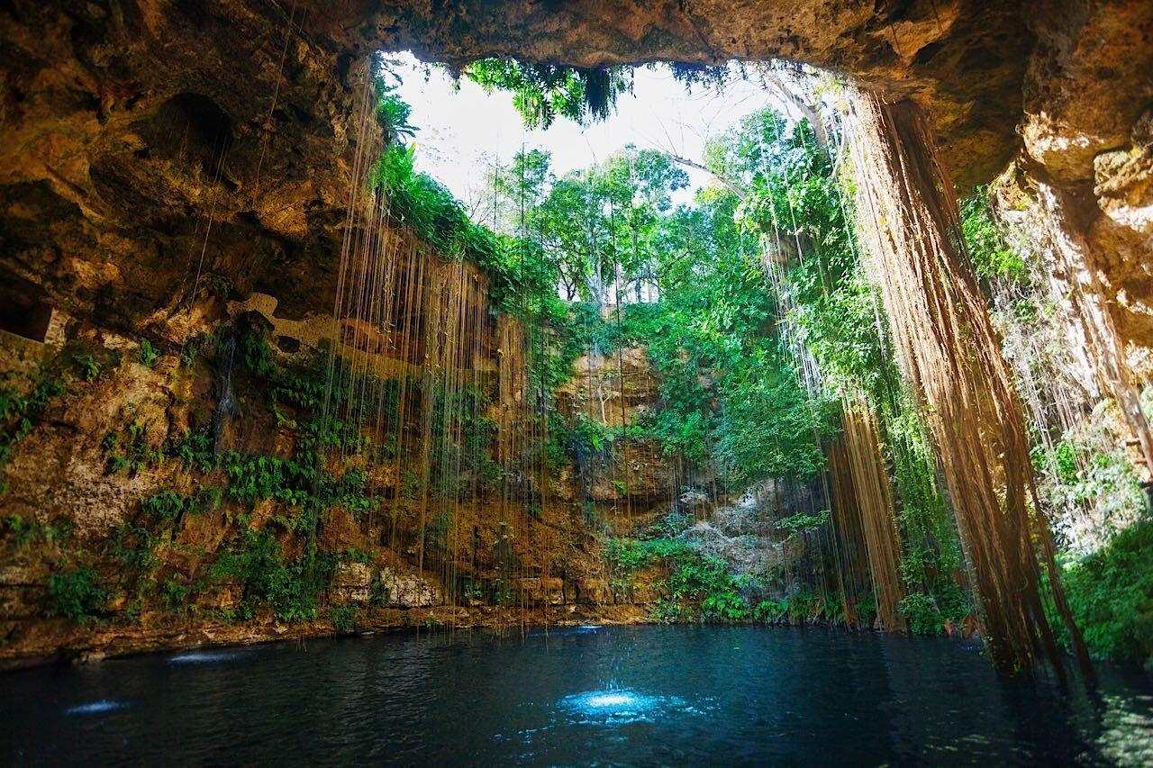 Sunbeams,Penetrating,At,Ik-kil,Cenote,Inlet, Mexico experience
