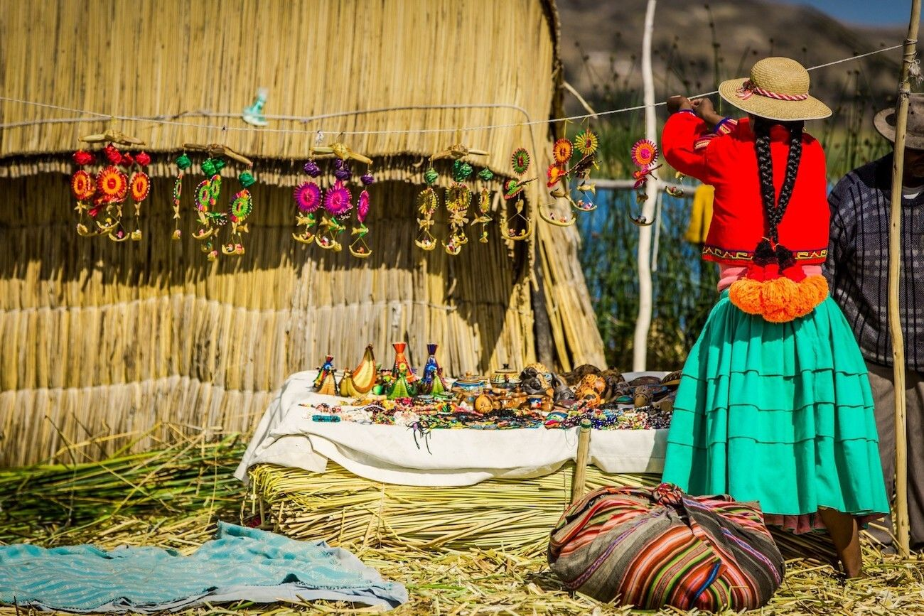 Local woman on the Uros Island displaying art and craft creations