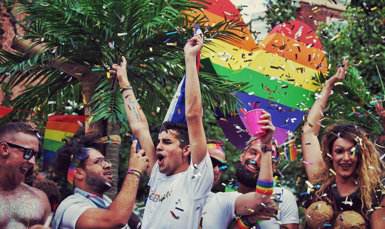 People-dancing-celebrating-at-LGBTQ-day-parties-1209022819