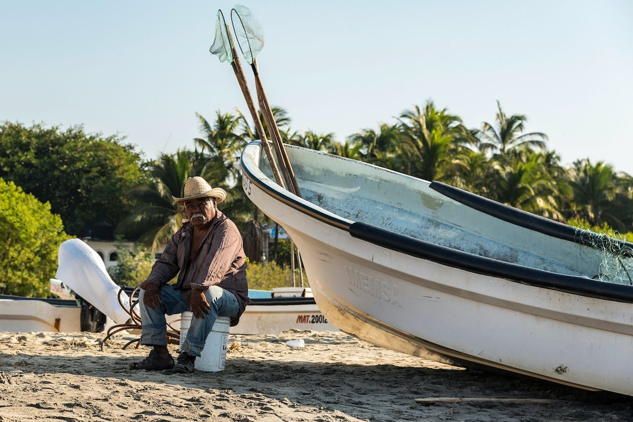 Mexico,,Oaxaca,,Puerto,Escondido,-,November,26,,2019:elderly,Fisherman,With, Puerto Escondido