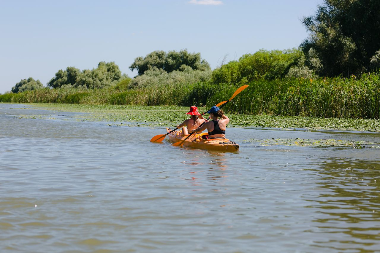 Tourists,Visiting,The,Danube,Delta,Delta,And,Its,Beauty, paddling the Danube Delta