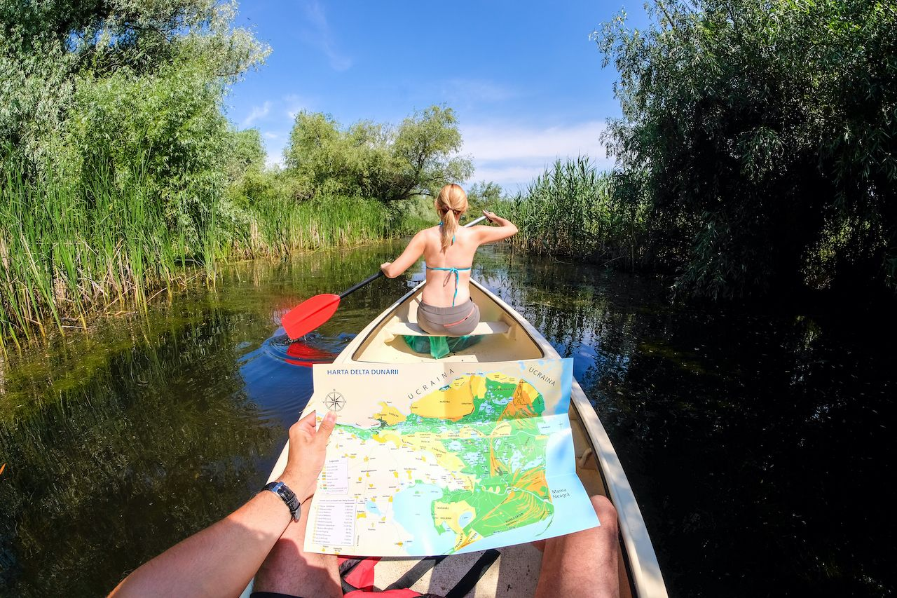 Danube,Delta,,Romania,,June,2017:,Tourists,Exploring,Danube,Delta,In, paddling the Danube Delta