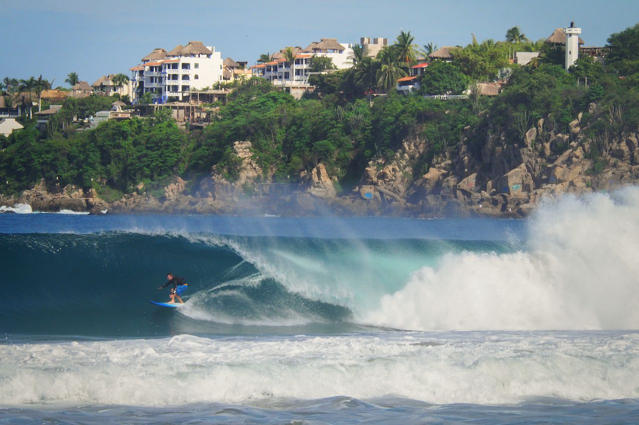 Surfer,In,The,Pipeline,Of,Playa,Zicatela,In,Puerto,Escondido, Puerto Escondido