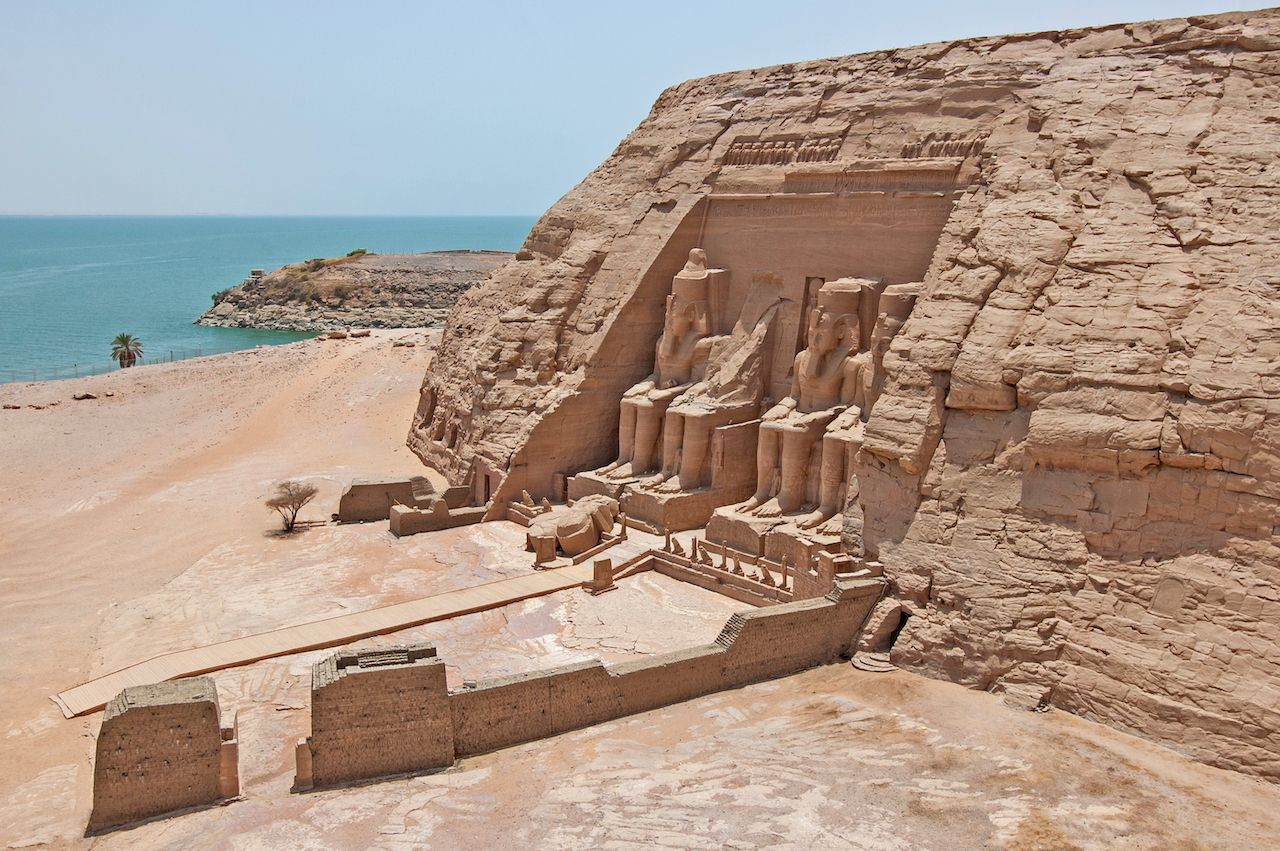 Aerial view over exterior entrance to ancient egyptian temple of Ramses II in Abu Simbel with giant statues to Lake Nasser, Nile cruise