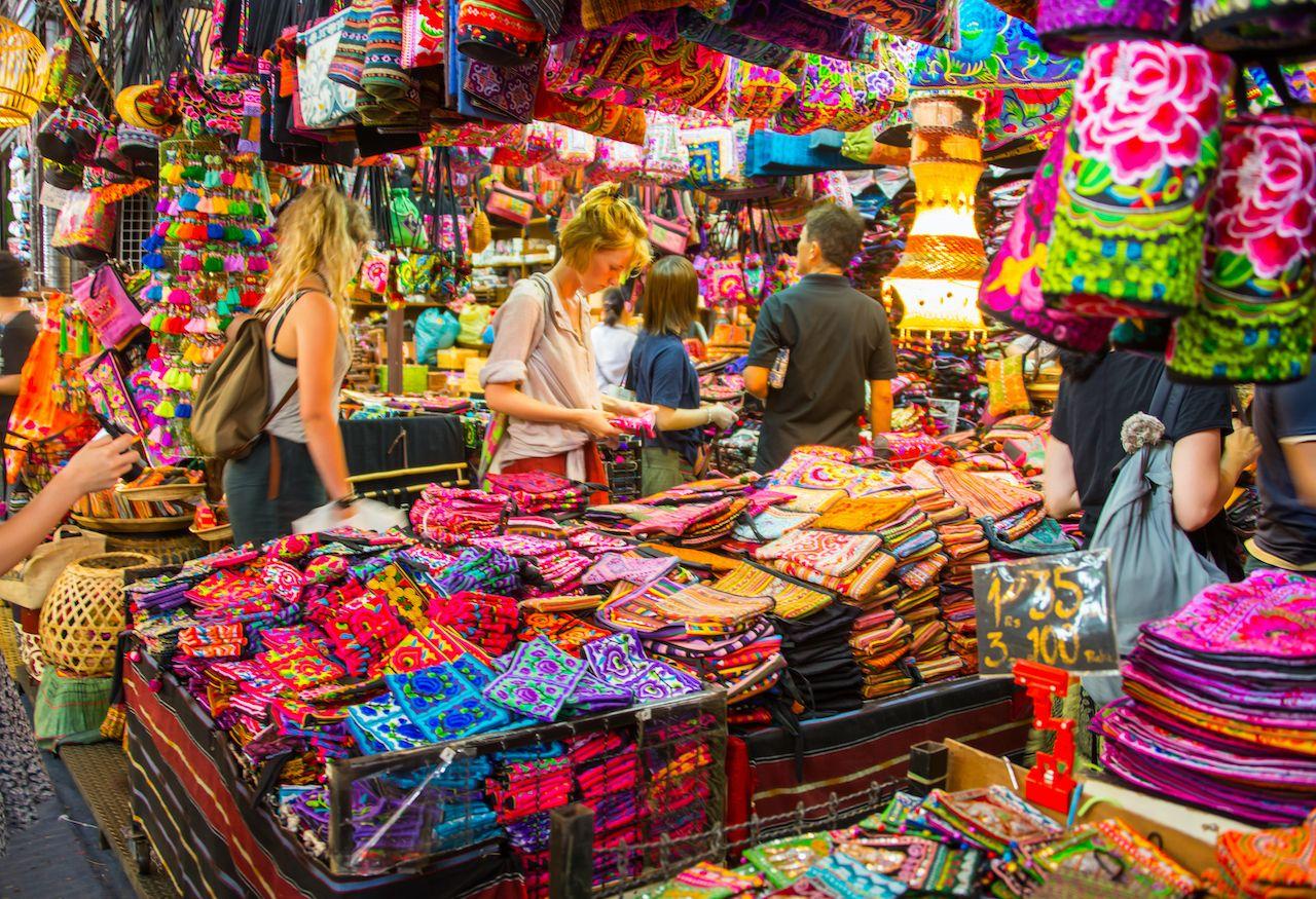 Bangkok, Thailand - Aug 24, 2016 - foreign tourist buys some Thai handicraft souvenirs at chatuchak market in bangkok, bangkok art and culture