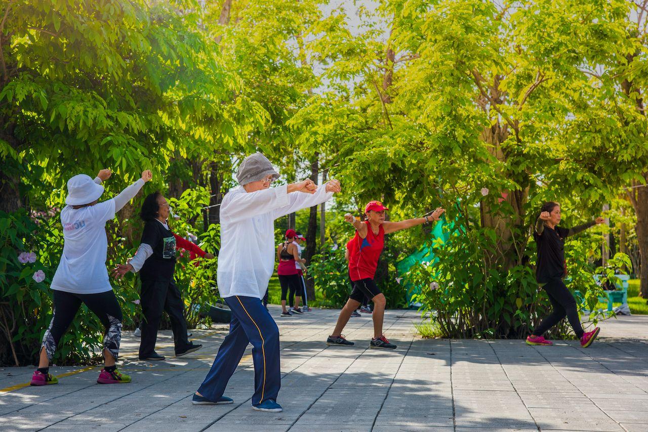BANGKOK,THAILAND-JUNE-06-2019:Old people are dancing Tai Chi, exercising in the park., bangkok art and culture
