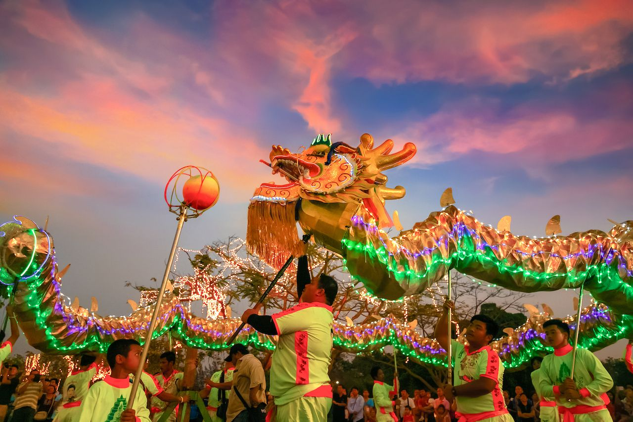 BANGKOK, THAILAND - FEBRUARY 20 2016: Unidentified group of people perform a traditional dragon dance at Rama IX public park to celebrate traditional Chinese's lunar new year, bangkok events