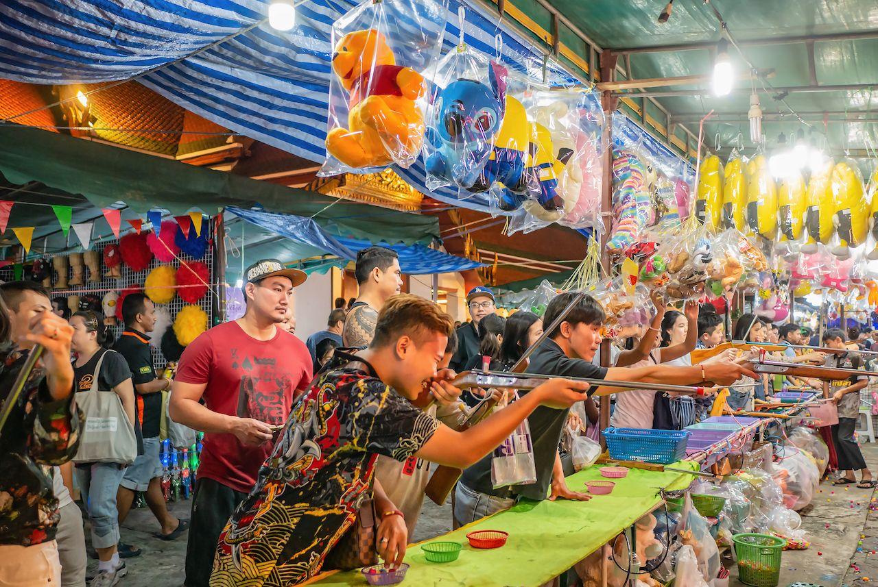 """Bangkok/Thailand - 10 Nov 2019:Unacquainted Thailand people or tourist Playing thai Local Street Shooting Game  in""""Loi Krathong"""" Temple Fair of Wat Saket Temple.Bangkok city Thailand, bangkok events"""