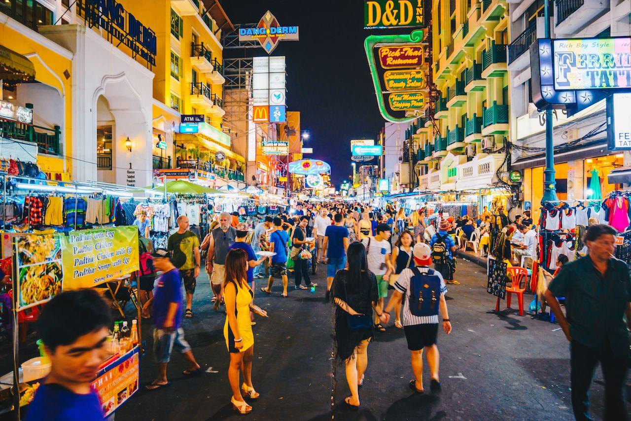 BANGKOK, THAILAND - FEBUARY 28, 2015: Tourist walking tour at Khaosan Road by night, a world famous backpacker district in Bangkok, Thailand, bangkok neighborhoods