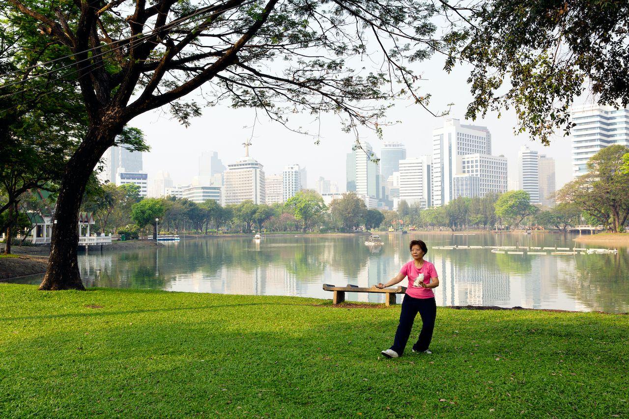 15.02.2013, Thailand, Bangkok, Lumphini Park. Woman practicing tai chi in the park., day two in Bangkok