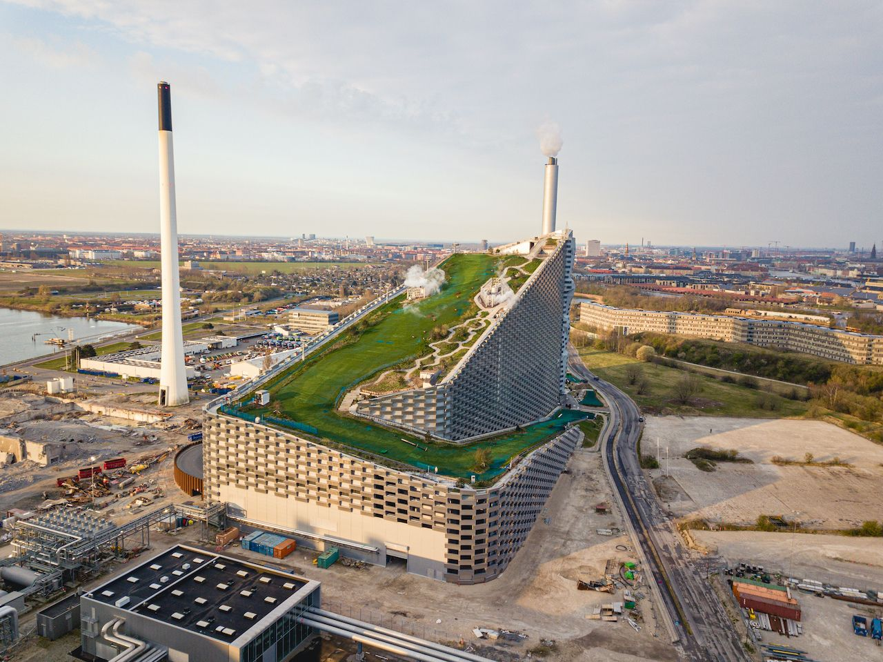 Copenhagen, Denmark - April 12, 2020: Aerial drone view of Amager Bakke, a waste to power plant with a ski slope on top., Denmark architecture