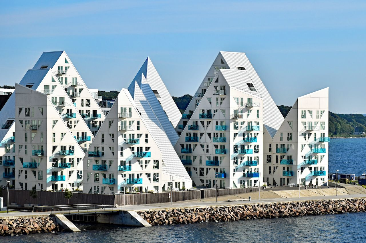 """Aarhus, Denmark - July 20, 2017: View from the sea side to the residential complex """"Isbjerget"""" (Iceberg) in Aarhus, Denmark. It is belonging to a new district on the harbor area near the town center., Denmark architecture"""