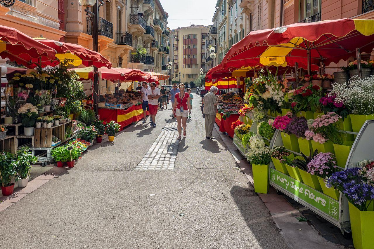 Monaco,,Monaco,-,5262018:,Brightly,Coloured,Market,Stalls,On,Grand, Monaco on a budget