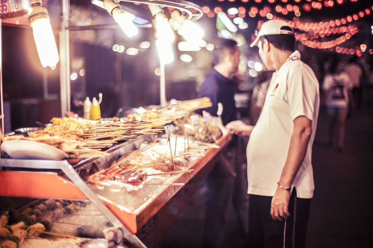Streetside Asian food vendor in Kuala Lumpur