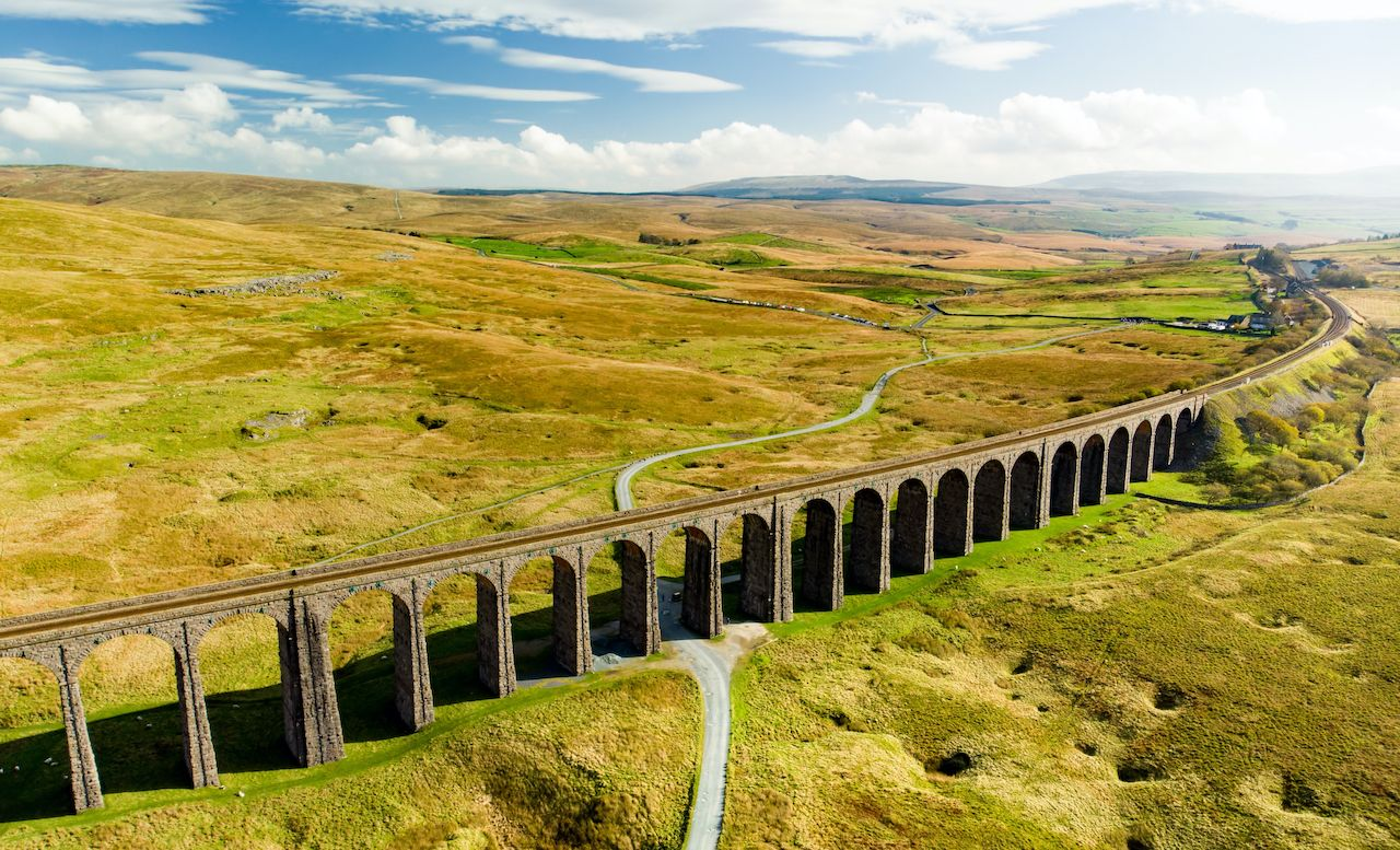 Aerial view of Ribblehead viaduct, located in North Yorkshire, the longest and the third tallest structure on the Settle-Carlisle line. Tourist attractions in Yorkshire Dales National Park, England., train journeys