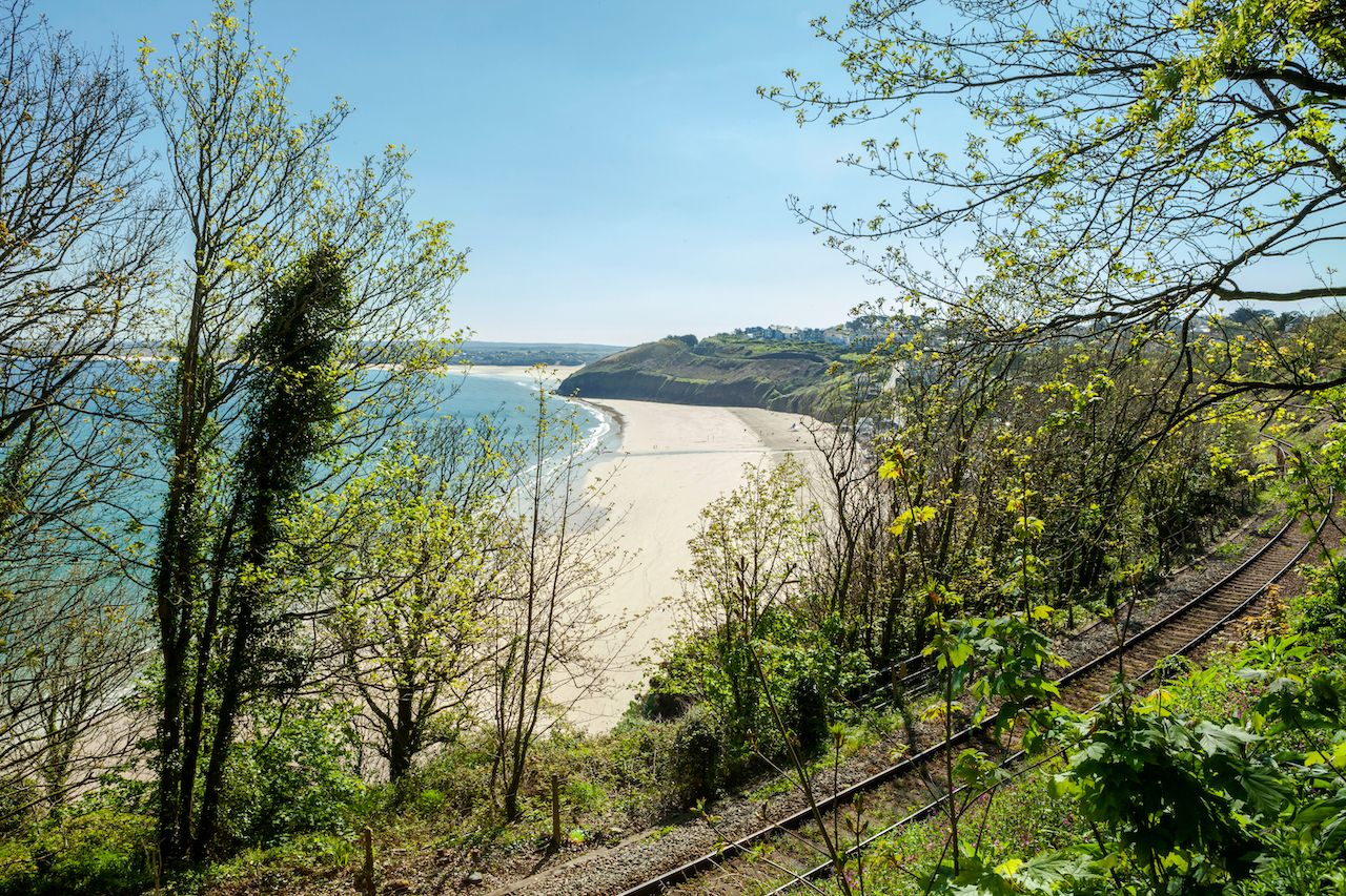 View overlooking Carbis bay in Cornwall and the railway line from the  St Ives Bay Line., train journeys