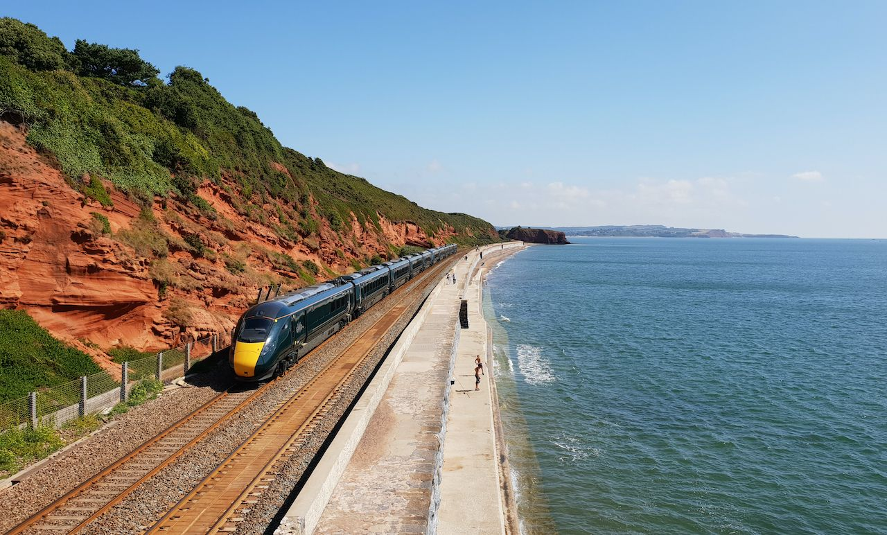 Dawlish United Kingdom August 3 2018 : Train pass between the Red cliff and the sea, Train journeys