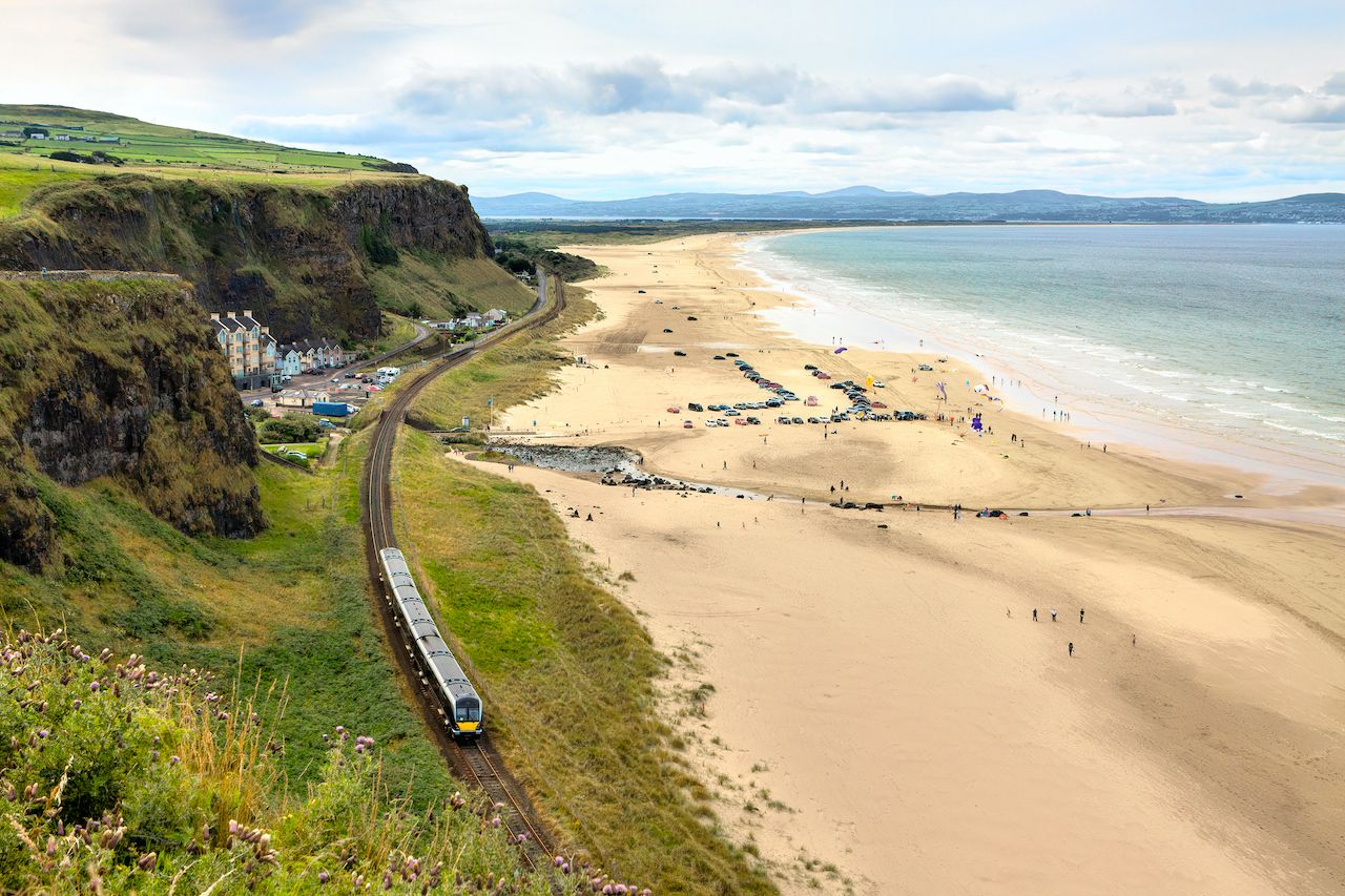 Downhill beach is located on the north coast of Northern Ireland between the towns of Limavady and Castlerock. It is part of the renowned Causeway coastal route., train journeys