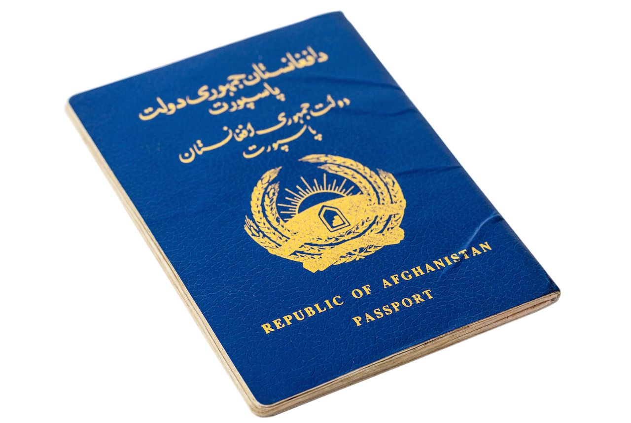Republic of Afghanistan passport isolated on white background, weakest passports